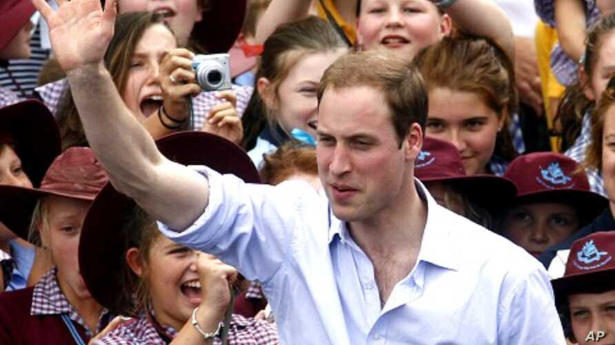 Britain's Prince William waves to residents as he leaves Kerang, March 21, 2011