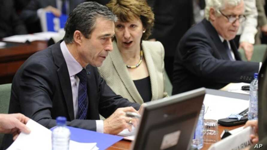 High Representative of the European Union for Foreign Affairs and Security Policy Catherine Ashton (R) speaks with NATO Secretary General Anders Fogh Rasmussen before a Defense Council meeting at the European Union headquarters in Brussels, 9 Dec 201