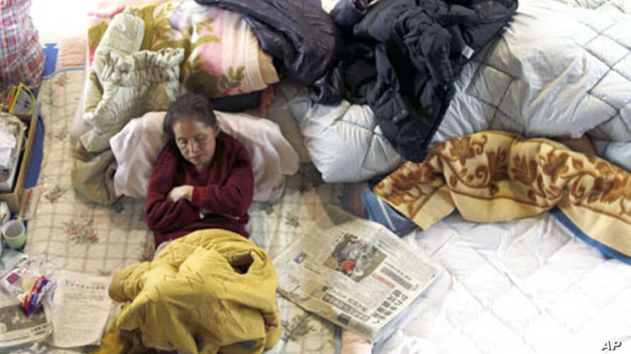A victim of the March 11 earthquake and tsunami rests at a shelter in Kamaishi, Iwate Prefecture. Displaced on the one-month anniversary of the deadly quake which triggered the tsunami and nuclear crisis in Japan, April 11, 2011