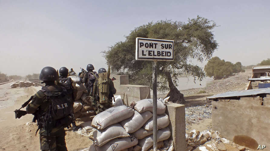 Cameroon soldiers stand guard at a lookout post as they take part in operations against the Islamic extremists group Boko Haram near the village of Fotokol, Cameroon.