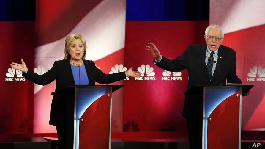 FILE - Democratic presidential candidates, former Secretary of State Hillary Clinton, left, and Sen. Bernie Sanders, I-Vt. talk over each other during the democratic presidential primary debate at the Gaillard Center, Jan. 17, 2016, in Charleston, S....
