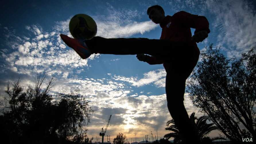 Fahim Ahmadi was a fast-rising football player in Afghanistan, and had played for his national youth team before joining the Hope Refugees United team in Athens. (J. Owens/VOA)