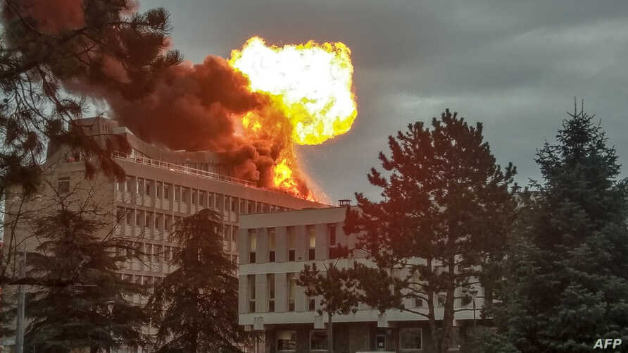 A picture taken on Jan. 17, 2019 in Villeurbanne near Lyon, shows an explosion on a rooftop of La Doua University Campus.