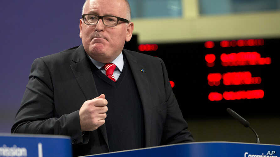 European Commission Vice-President Frans Timmermans speaks during a media conference at EU headquarters in Brussels on Wednesday, Dec. 20, 2017.