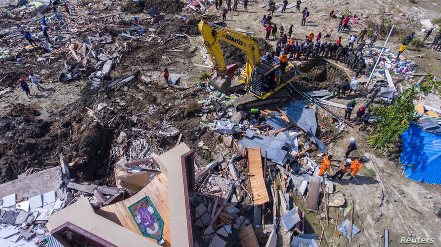 An aerial view shows the evacuation process near a collapsed church after an earthquake in Sigi, south of Palu, Central Sulawesi, Indonesia, Oct. 4, 2018 in this photo taken by Antara Foto.