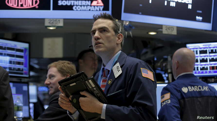 Traders work on the floor of the New York Stock Exchange (NYSE) March 4, 2016.