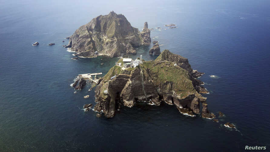 A set of remote islands called Dokdo in Korean and Takeshima in Japanese is seen in this picture taken from a helicopter August 10, 2012.