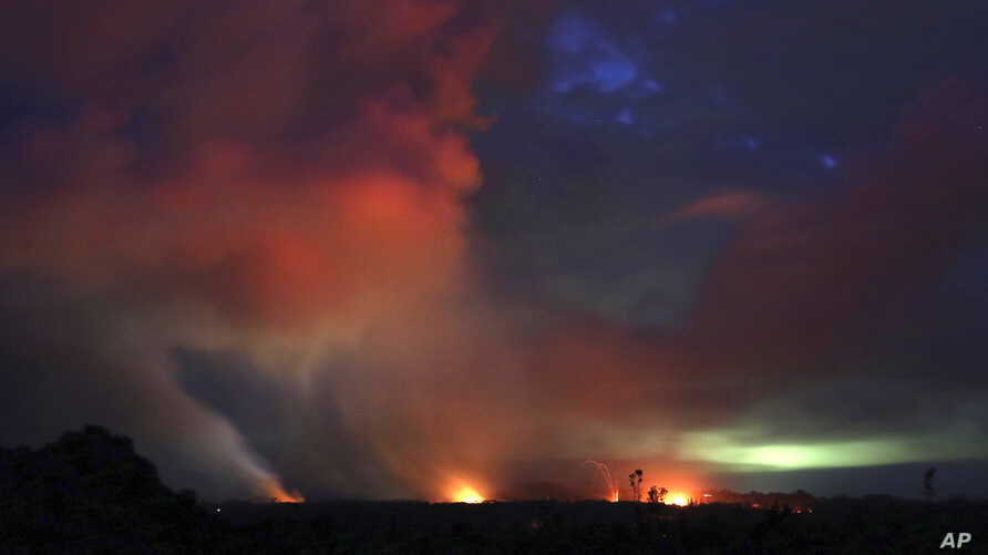Lava shoots into the night sky from active fissures on the lower east rift of the Kilauea volcano, May 15, 2018, near Pahoa, Hawaii.