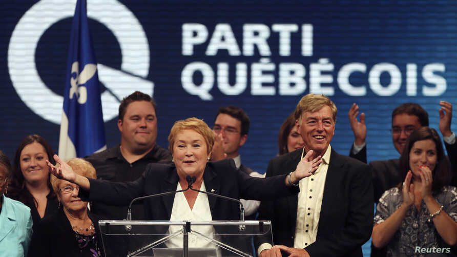Parti Quebecois leader Pauline Marois stands with her family after winning a minority government in the Quebec provincial election in Montreal, Quebec, September 4, 2012.