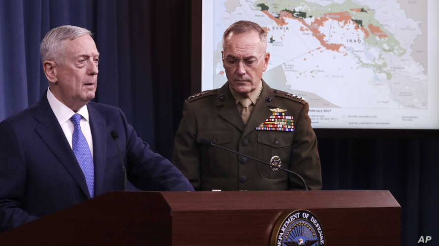 Defense Secretary Jim Mattis, left, and Joint Chiefs Chairman Gen. Joseph Dunford Jr., participate in a news conference at the Pentagon, May 19, 2017.