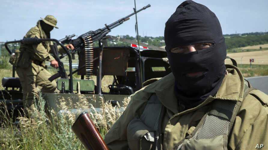 Pro-Russian fighters stand in their positions as they patrol the airspace near Luhansk, eastern Ukraine, July 2, 2014.