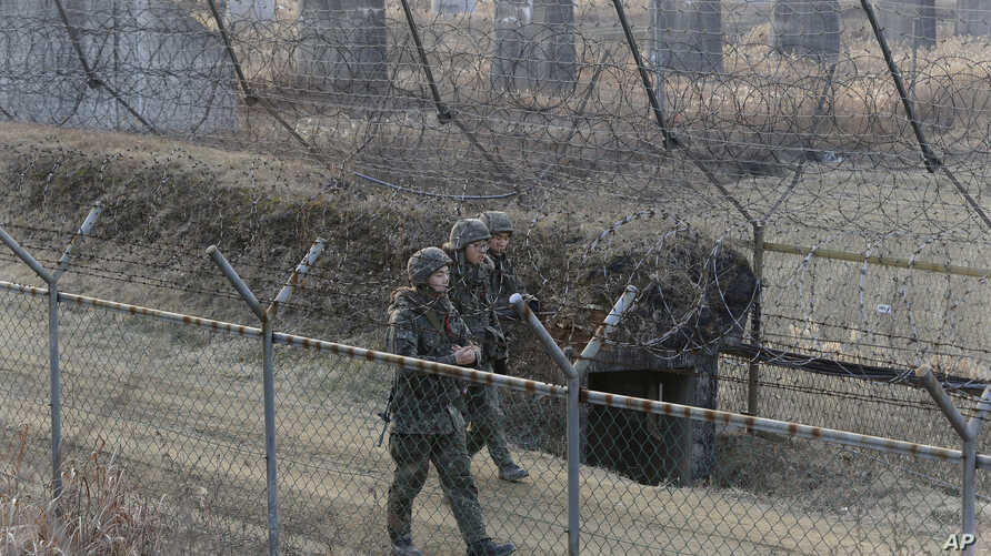 South Korean army soldiers patrol the barbed-wire fence in Paju, near the border with North Korea, South Korea, Wednesday, Jan. 6, 2016.