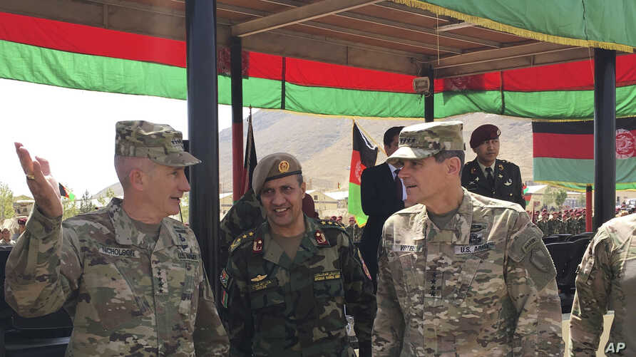 FILE - In this Aug. 20, 2017, photo, U.S. Gen. John Nicholson, top U.S. commander in Afghanistan, left, talks with Col. Khanullah Shuja, commander of the Afghan special operations force, and U.S. Gen. Joseph Votel, head of U.S. Central Command, at Ca