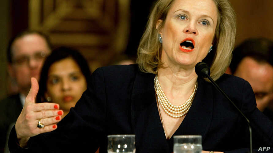 FILE - Former U.S. Ambassador Robin Raphel, shown during a Senate Foreign Relations Committee Hearing in Washington in 2004, is under federal investigation.