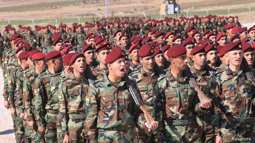 A group of Arab soldiers who have joined Kurdish peshmerga forces take part in their graduation ceremony at a training camp in Duhok province, Iraq, Feb. 7, 2017.