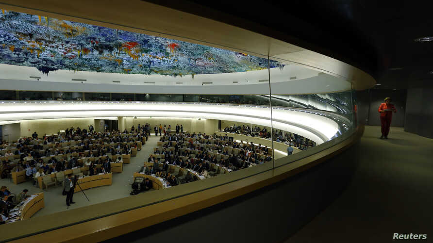 A staff member walks along a corridor during the 26th session of the Human Rights Council at the United Nations in Geneva, Switzerland, June 10, 2014.