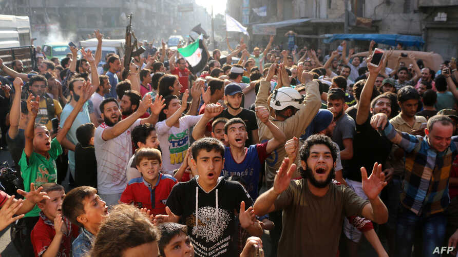 Syrians gather in a street in the northern city of Aleppo on Aug. 6, 2016, in celebrations after rebels said they have broken a three-week government siege on Syria's second city.