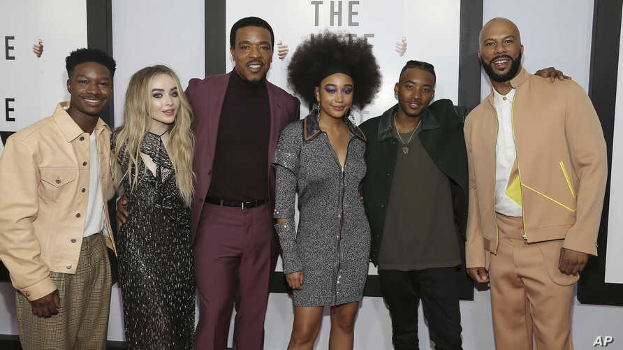 """Actors Lamar Johnson, Sabrina Carpenter, Russell Hornsby, Amandla Stenberg, Algree Smith and Common, from left, attend a screening of """"The Hate U Give"""" at The Paris Theater on Thursday, Oct. 4, 2018, in New York."""