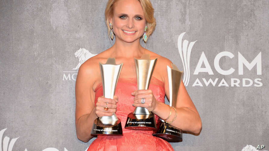 Miranda Lambert poses in the press room with the awards for Vocal Event of the Year, Female Vocalist of the Year and Single Record of the Year at the 49th annual Academy of Country Music Awards at the MGM Grand Garden Arena in Las Vegas, April 6, 201