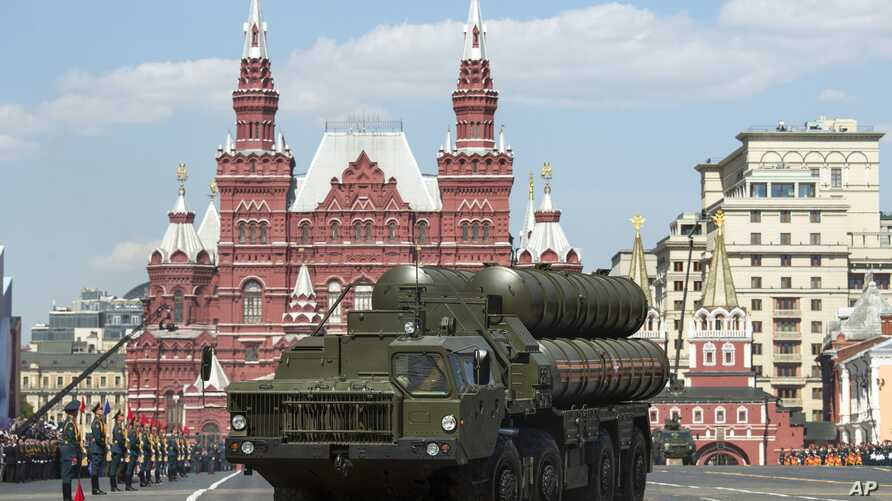 FILE - Russian S-400 air defense missile systems drive during the Victory Day military parade marking 71 years after the victory in WWII in Red Square in Moscow, Russia, May 9, 2016.