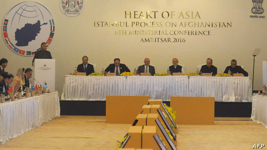 Indian Prime Minister Narendra Modi (C), Afghan President Ashraf Ghani (8L), Indian Finance Minister Arun Jaitley (2R) and Indian Union Minister VK Singh (R) listen to a speaker at the 6th Heart of Asia (HoA) Ministerial Conference in Amritsar, India