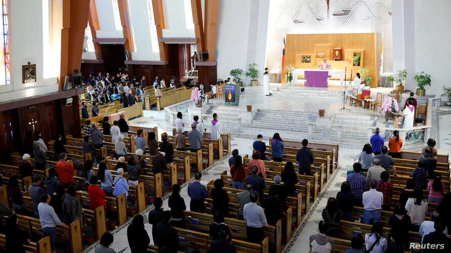 FILE - Catholics attend Mass at a church in Taipei, Taiwan, March 11, 2018. Picture taken March 11, 2018.