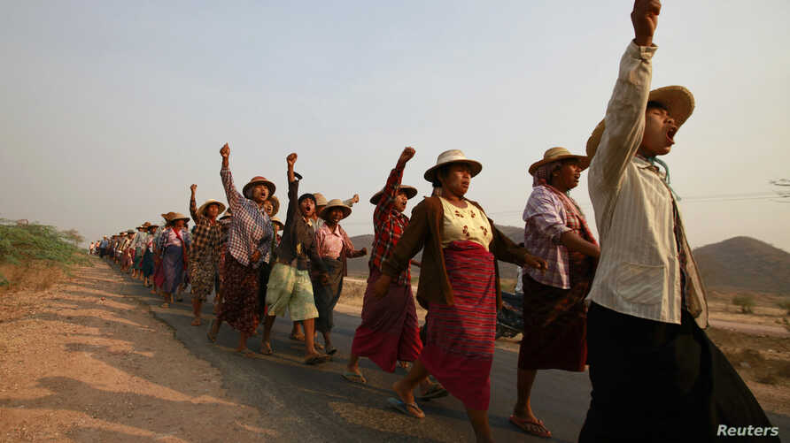 FILE - Villagers protest against land seizures for a copper mine project at Lapdaung Hill, in Sarlingyi township, Myanmar, March 13, 2013.