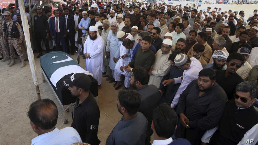 People offer funeral prayer of Sabika Sheikh, Pakistani exchange student killed in a mass shooting at a high school in Texas, in Karachi, Pakistan, May 23, 2018.
