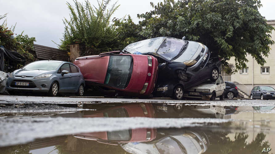 Damaged cars are pictured the day after floods hit the town of Trebes, southern France, Tuesday, Oct. 16, 2018. French officials say flash floods that swept through the southwest Aude region largely claimed elderly victims, who were seemingly caught
