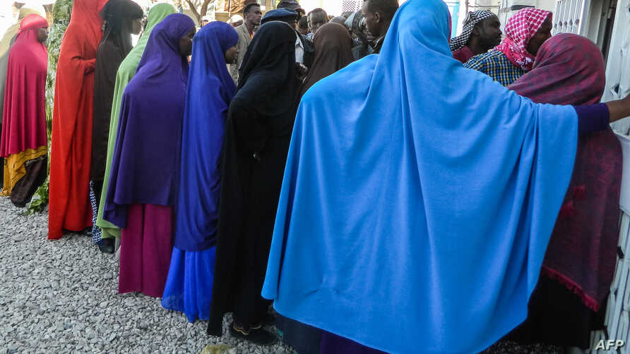 FILE - People wait in a line to cast their votes in the Presidential election at a polling station in Hargeisa, Somaliland, Nov. 13, 2017.