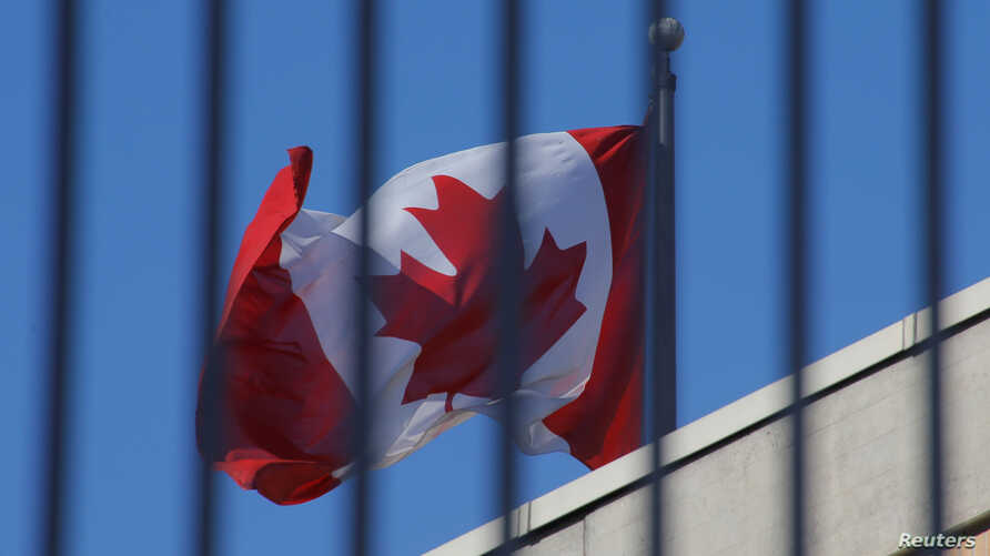 The Canadian national flag flies above the Canadian embassy in Beijing, China, Jan. 15, 2019.