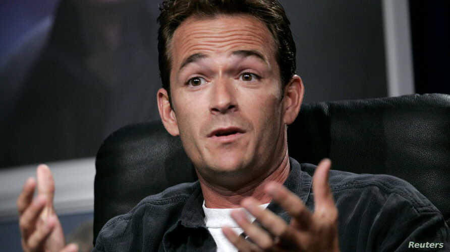 "FILE - Actor Luke Perry reacts at the panel for Hallmark channel's ""Supernova"" show during the Television Critic's Association Summer press tour at the Beverly Hilton Hotel, Beverly Hills."
