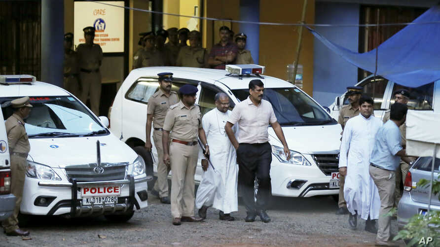 Franco Mulakkal, bishop of the Indian city of Jalandhar, center, whom a nun has accused of rape, returns after appearing for questioning by police in Kochi, India, Sept. 19, 2018. The bishop has denied the accusation.
