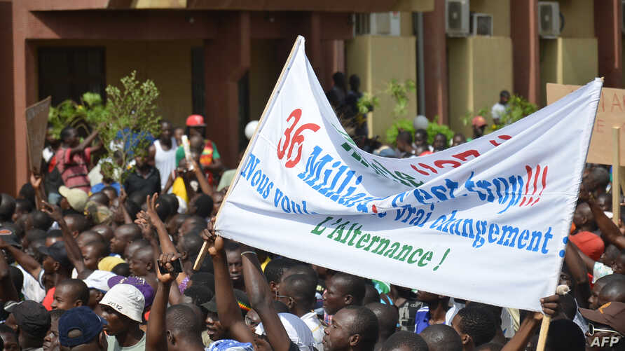 People march during an opposition protest in Ouagadougou on July 28, 2013 against the creation of a Senate which they say will enable the President to extend his 26-year rule.
