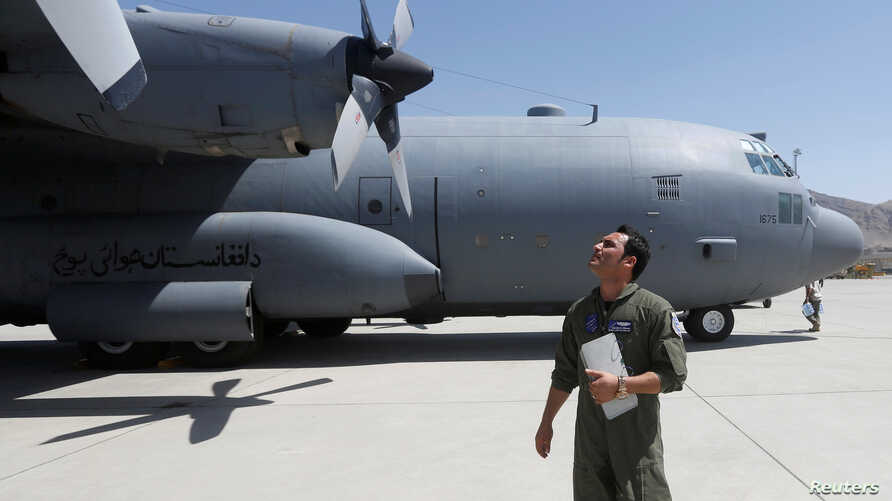 FILE - An Afghan Air Force pilot checks a C-130 military transport plane before a flight in Kabul, Afghanistan, July 9, 2017.