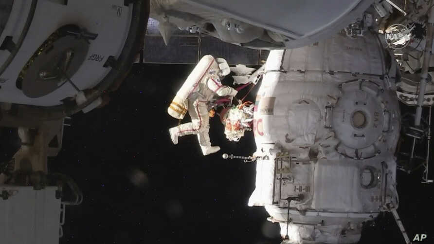 In this image from video made available by NASA, Russian cosmonaut Oleg Kononenko performs a spacewalk outside the International Space Station, Dec. 11, 2018.