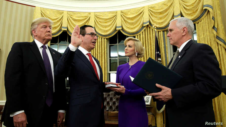 U.S. President Donald Trump, left, watches as Vice President Mike Pence, right, swears in Steve Mnuchin as Treasury Secretary next to his fiancé, Louise Linton, in the Oval Office of the White House in Washington, Feb. 13, 2017.