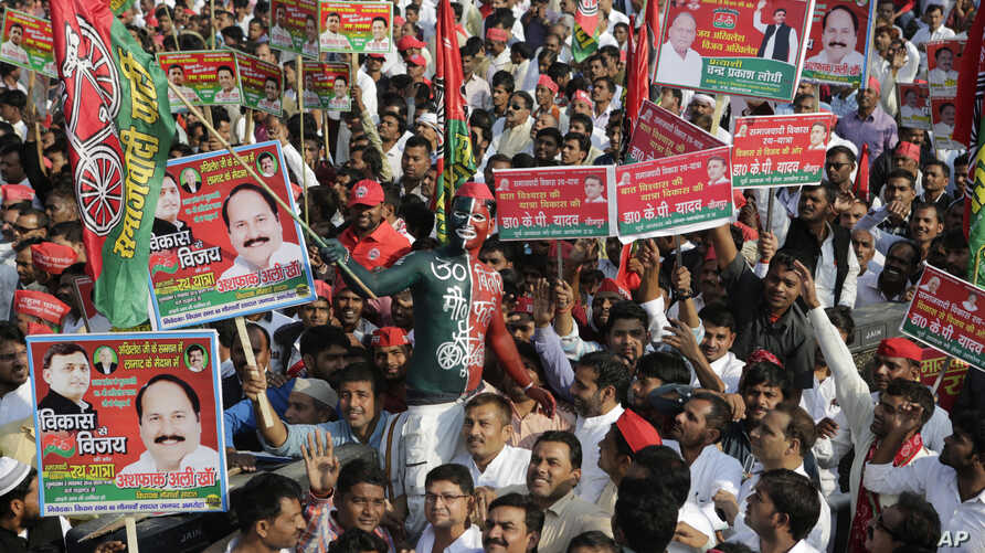 FILE - Samajwadi Party supporters gather for the launch of the party's election campaign for the state of Uttar Pradesh, in Lucknow, India, Nov. 3, 2016.
