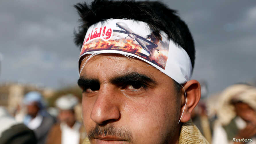 FILE - A Houthi supporter wears a headband praising the Houthi movement for making drone aircraft as he attends a pro-Houthi rally in Sana'a, Yemen March 3, 2017.