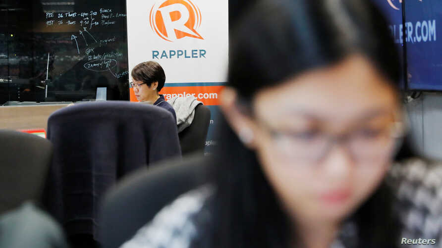 Journalists work at the office of Rappler in Pasig, Metro Manila, Philippines, Jan. 15, 2018.