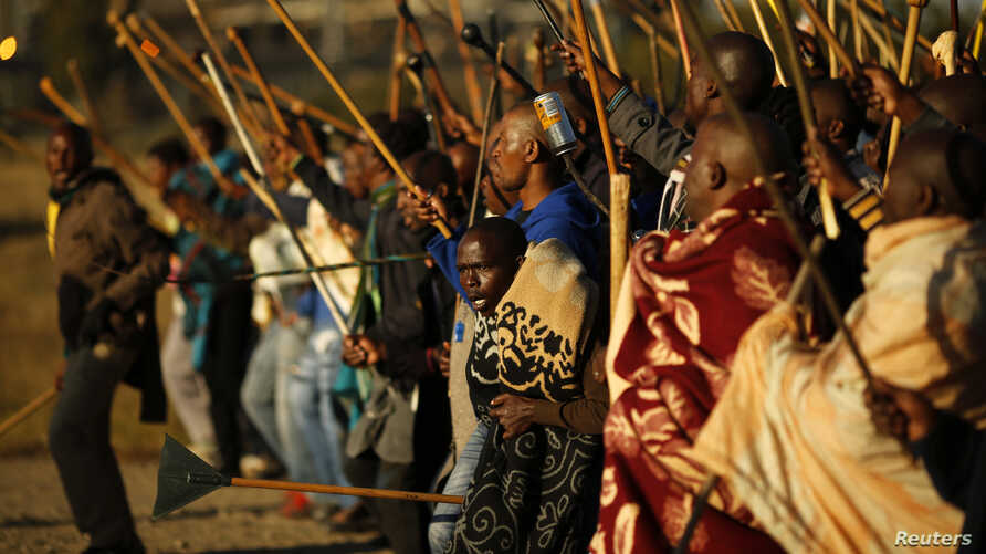 Miners on strike chant slogans as they march in Nkaneng township outside the Lonmin mine in Rustenburg May 14, 2014.