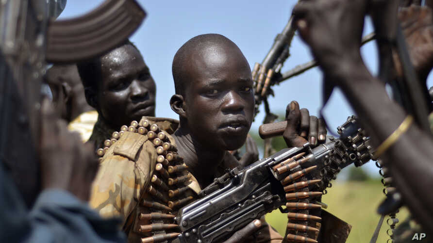FILE-- In this file photo of Friday, Sept. 25, 2015. South Sudan government soldiers in the town of Koch, Unity state, South Sudan.