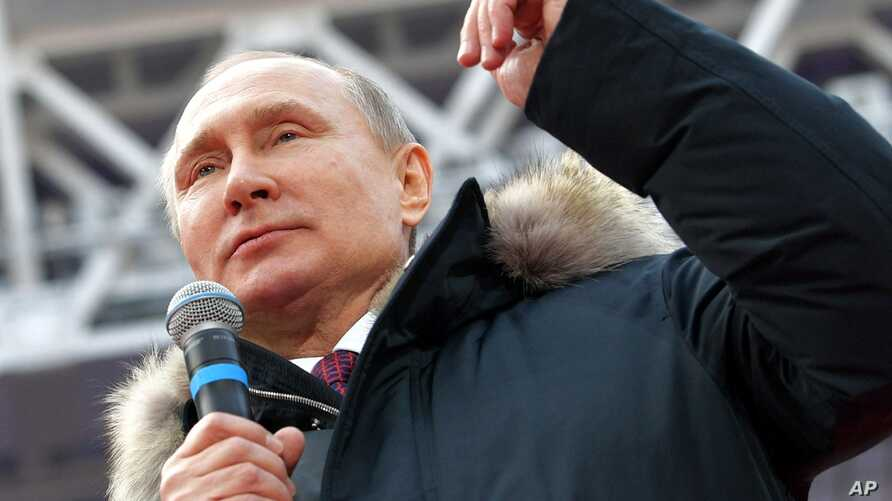 FILE - Russian President Vladimir Putin speaks during a massive rally in his support as a presidential candidate at the Luzhniki stadium in Moscow, Russia, March 3, 2018.