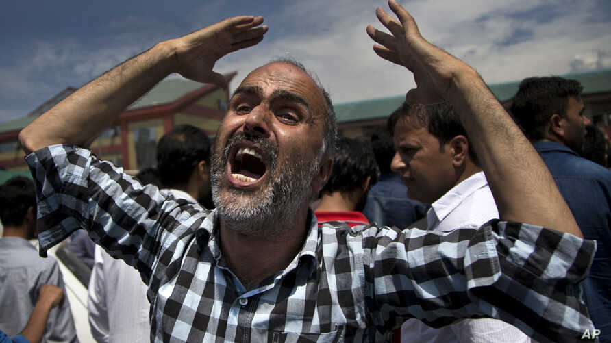 A Kashmiri Muslim man shouts pro-freedom slogans while protesting against the killing of civilian outside a local hospital in Srinagar, Indian-controlled Kashmir, Aug. 24, 2016. The civilian died of pellet injuries as protests continued in the valley