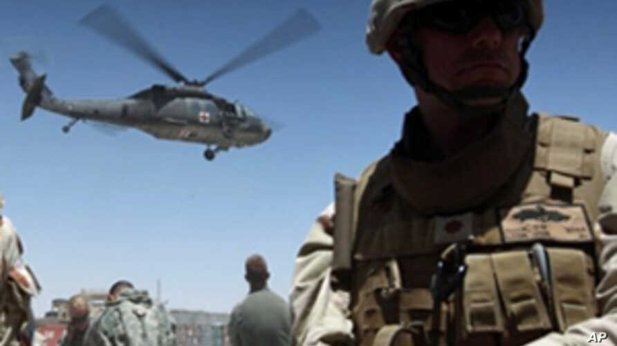 A medevac helicopter lifts off from Camp Nathan Smith in Kandahar city, carrying an unidentified NATO soldier on 9 June 2010