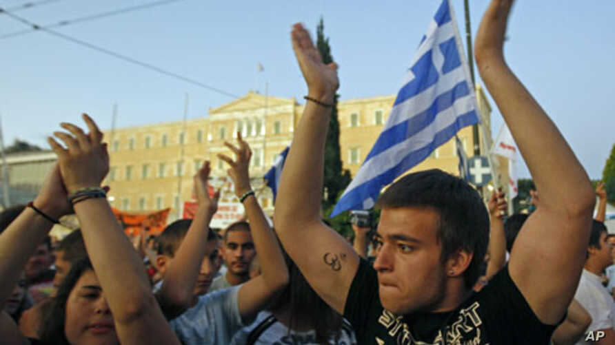 Protesters shout slogans during a rally against the austerity economic measures and corruption, in front of the parliament in Athens' Syntagma [Constitution] in Greece, June 23, 2011