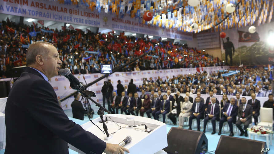 Turkey's President Recep Tayyip Erdogan addresses members of his ruling party in Ordu, Turkey, March 24, 2018. Erdogan criticized anti-war students at a top university, calling them terrorists following a fight there.