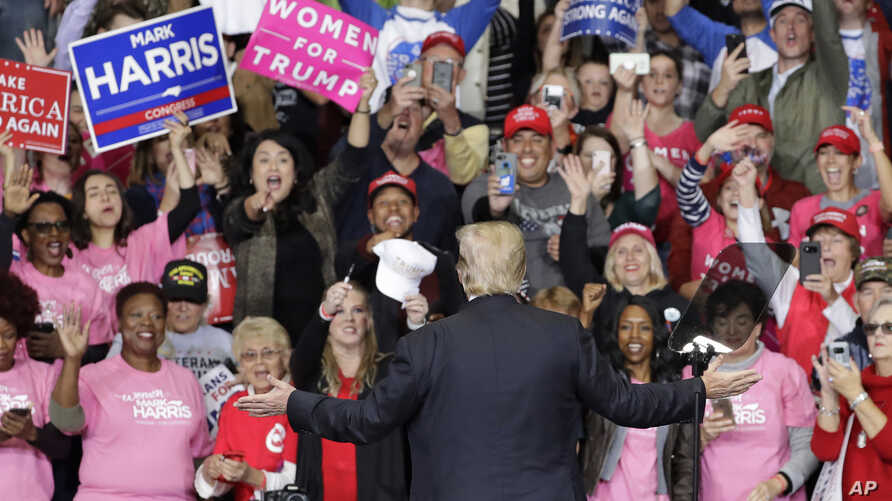President Donald Trump gestures to the crowd during a campaign rally in Charlotte, N.C., Oct. 26, 2018.