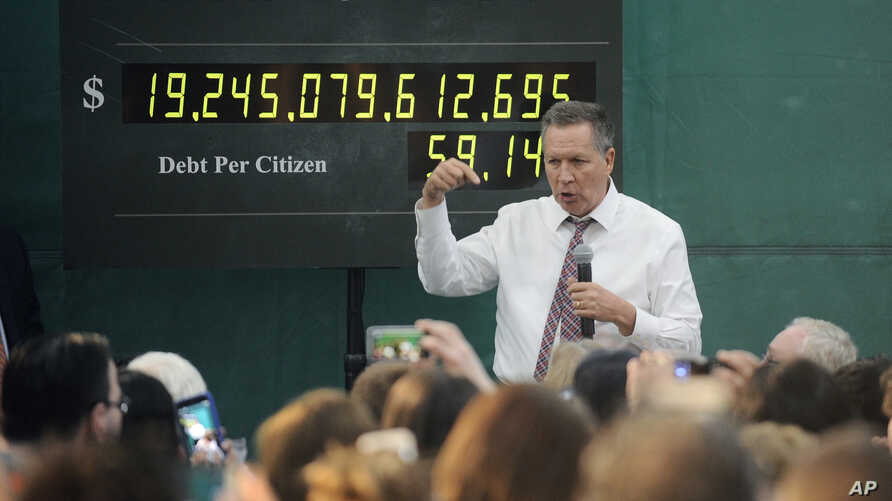 FILE - Ohio Gov. John Kasich talks about the national debt at Mohawk Valley Community College in Utica, N.Y., in his bid for the 2016 Republican presidential nomination, April 15, 2016.