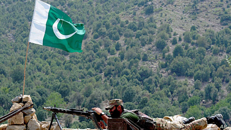 A Pakistani soldier is pictured on Manatu mountain in  Kurram Agency, Pakistan's tribal belt bordering Afghanistan, during an operation against militants on July 10, 2011.